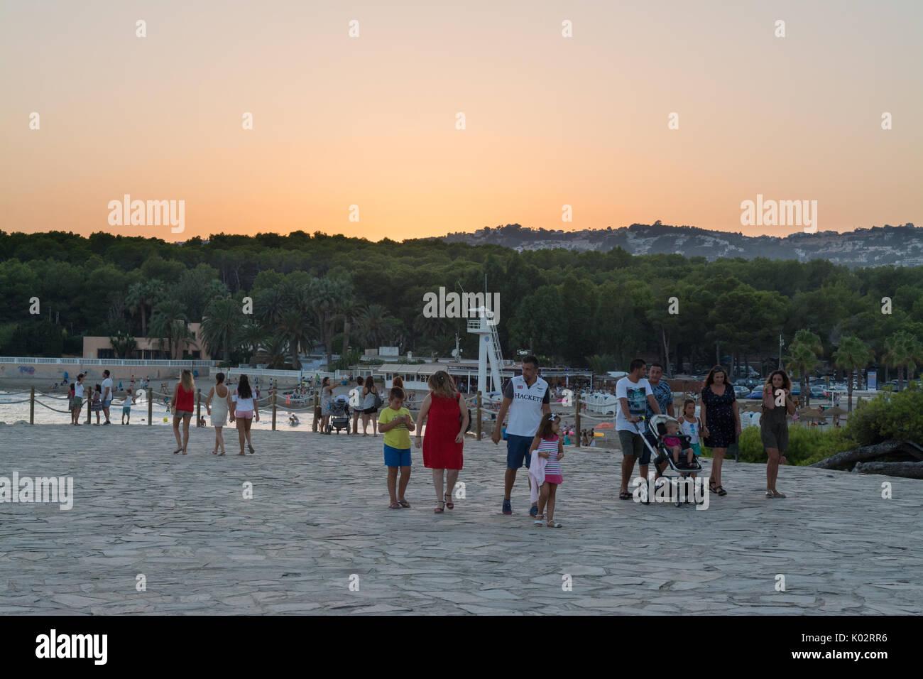 Moraira promenade - families strolling at sunset - Stock Image