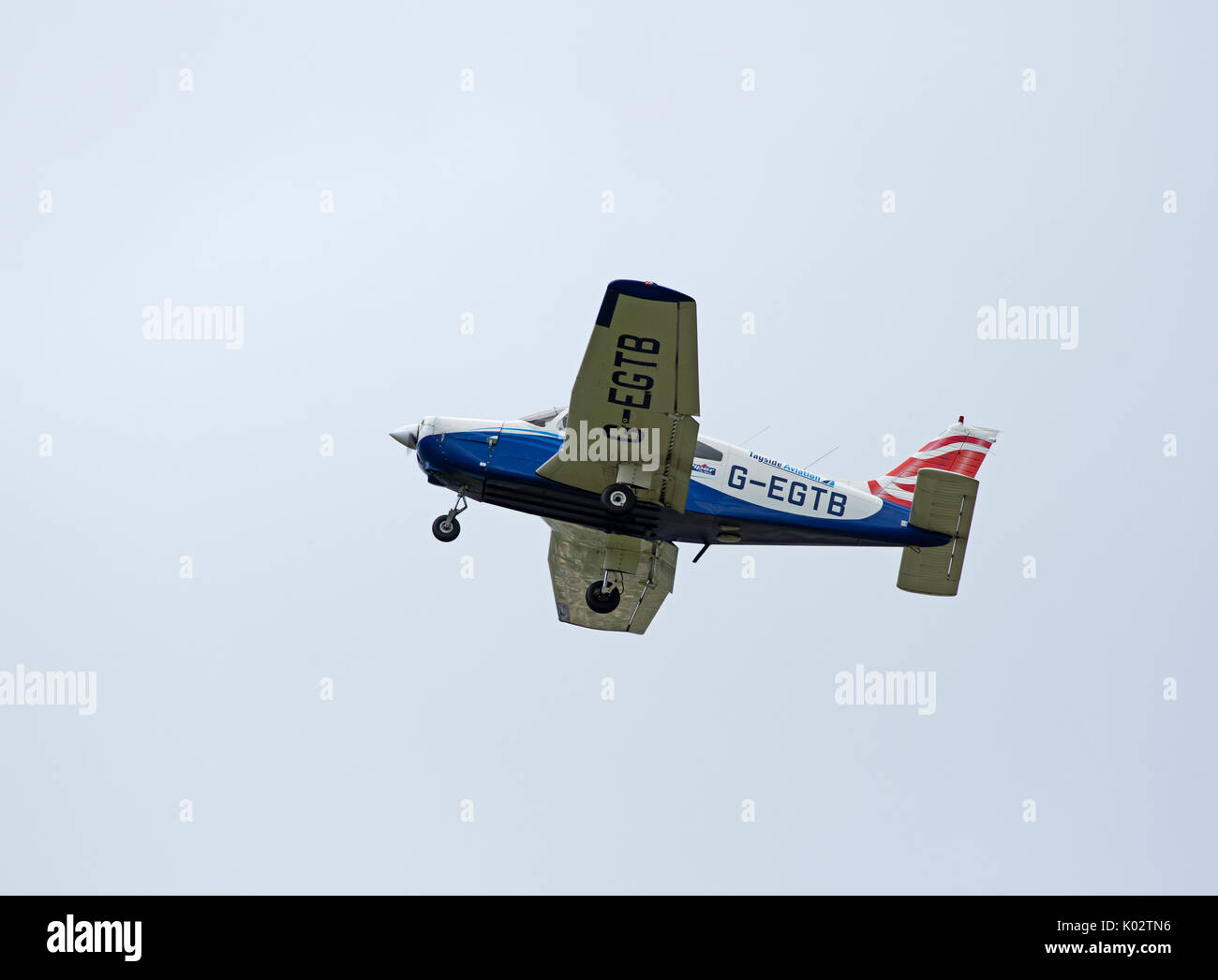 Piper PA-28-161 Warrior on a visit from Tayside Aviation Ltd on the short flight to Inverness airport in the Scottish Stock Photo