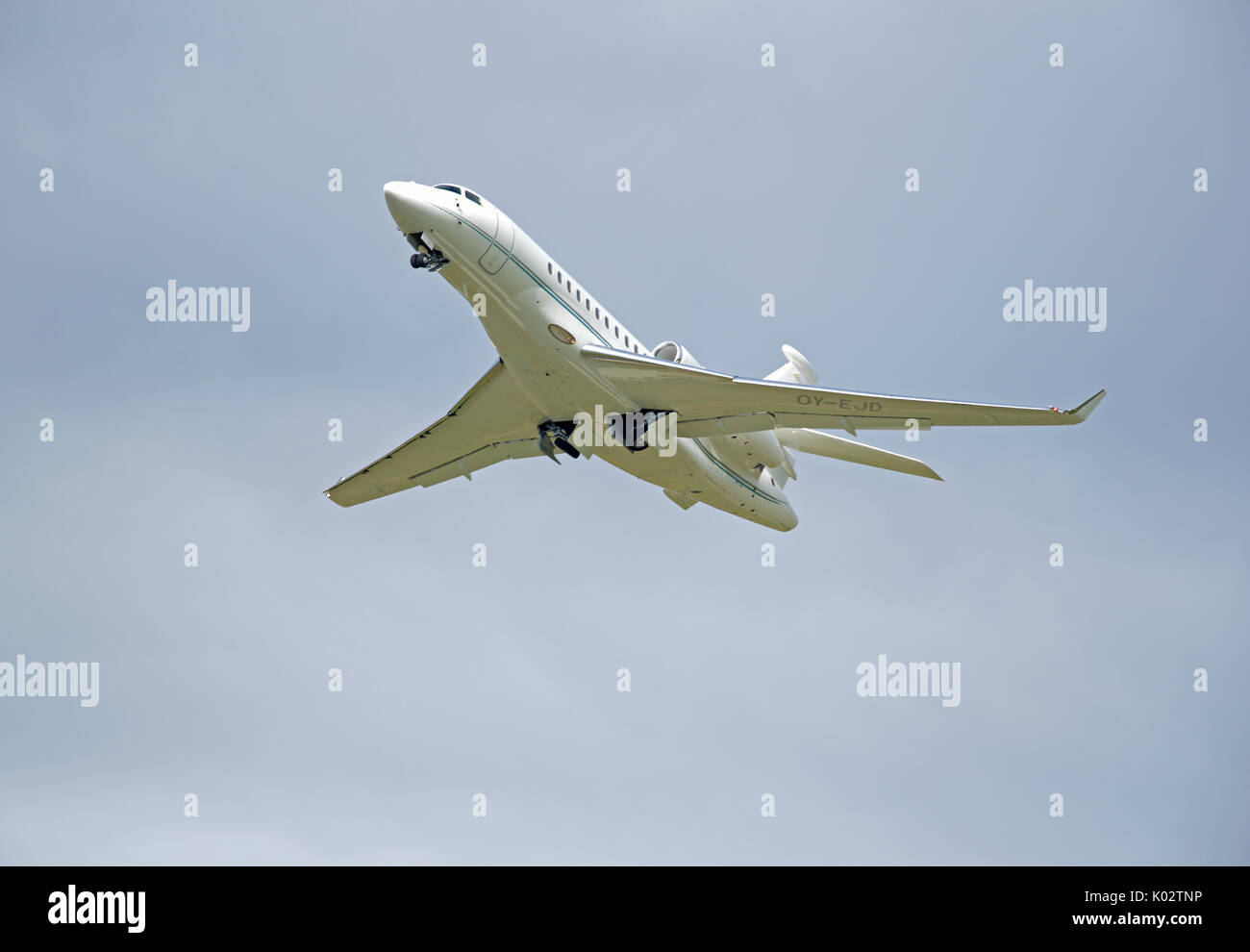 Falcon 7X from Air Alsie Fleet departing from Inverness Dalcross Airport in the Scottish Highlands UK. Stock Photo