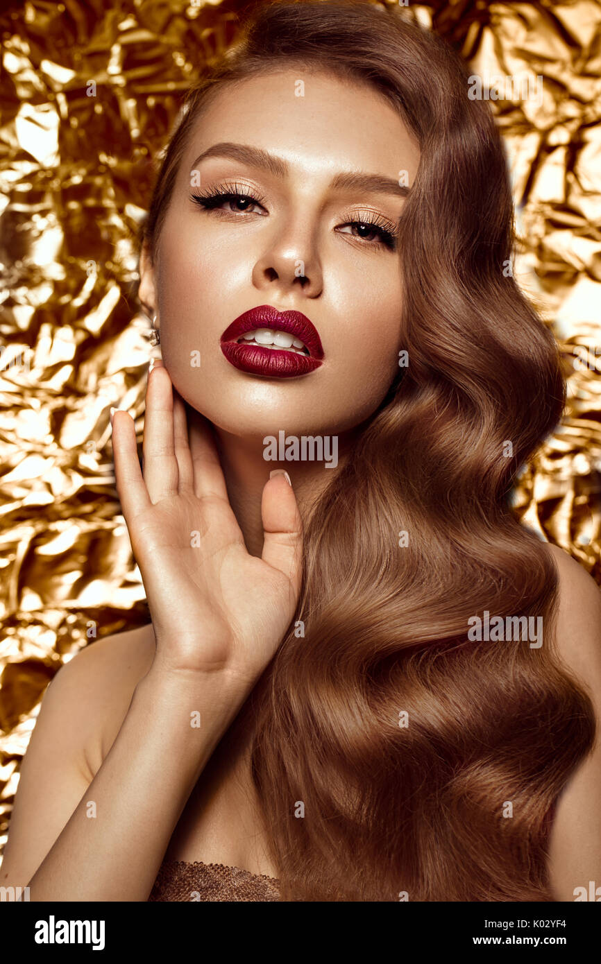 beautiful girl in Hollywood image with wave and classic makeup. Beauty face. - Stock Image