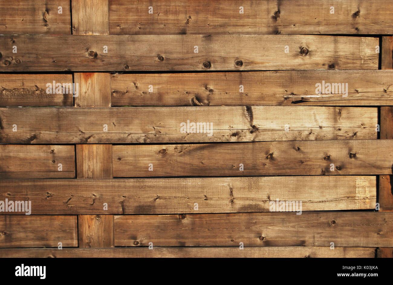 The texture of a wooden wicker fence of horizontal orientation - Stock Image