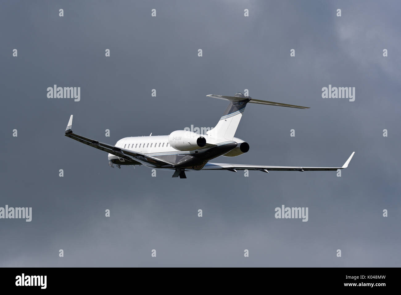Bombardier Global Express BD 700 executive jet G-GLOB owned by Execujet of Cambridge taking off at Biggin Hill Airport, Kent, UK. Space for copy - Stock Image