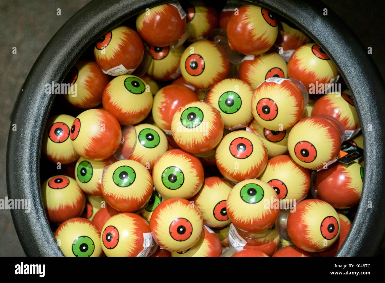 A container with plastic eyeballs for sale at the Halloween Advenrture in Greenwich Village, New York City.America, American, fake, - Stock Image