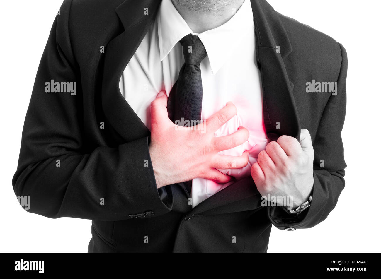 Businessman holding his heart in pain in black and white picture as heart attact or palpitation concept - Stock Image