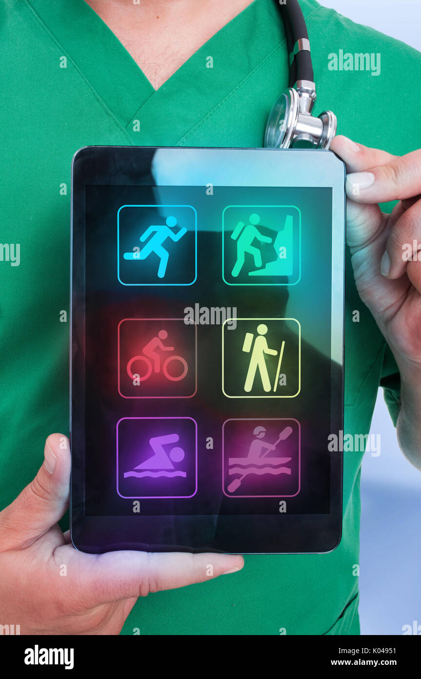 Closeup view of male physiotherapist holding touchpad with different sports icons on the screen for body recovery - Stock Image