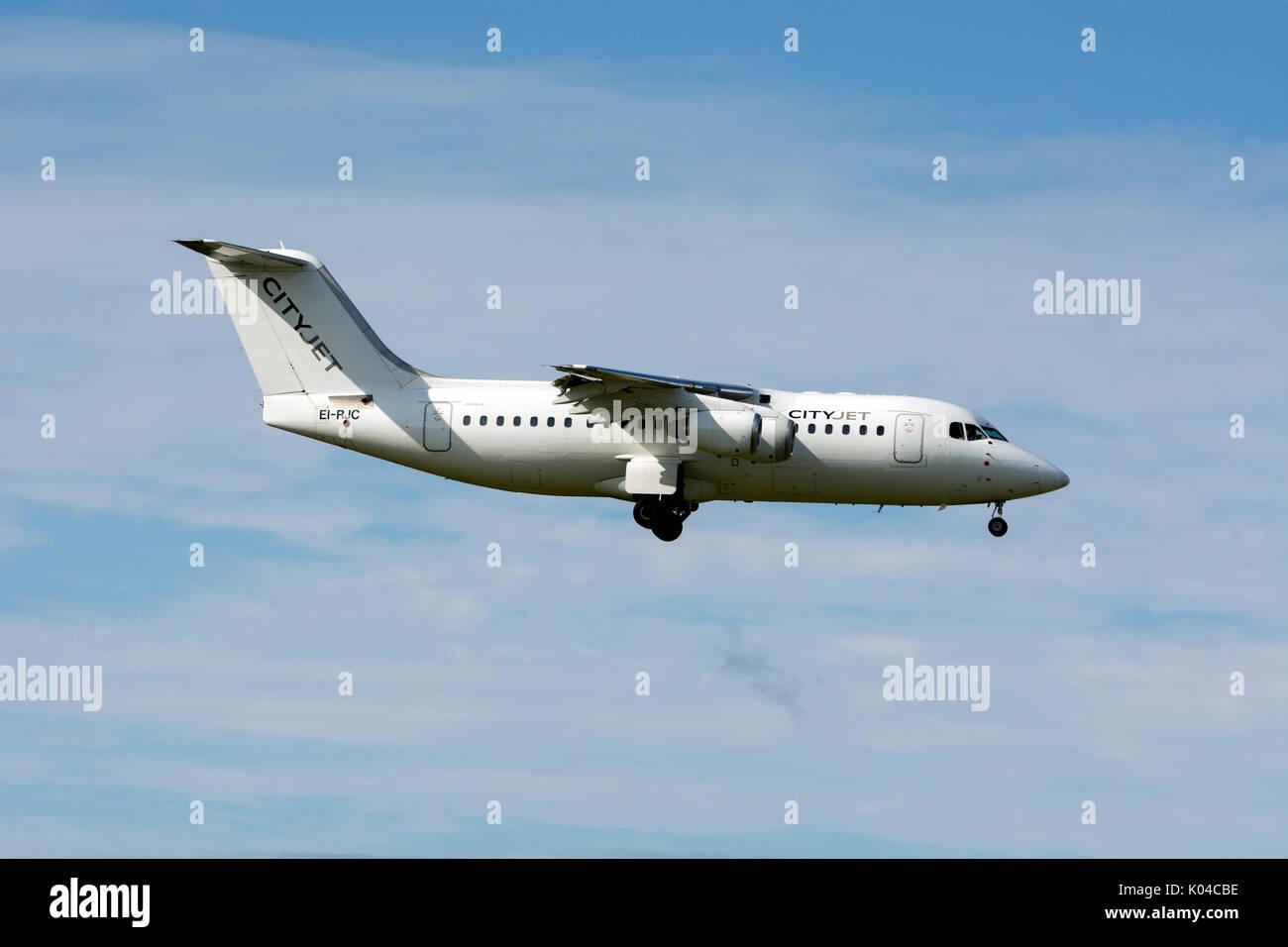 Cityjet Avro RJ85 landing at Birmingham Airport, UK (EI-RJC) - Stock Image