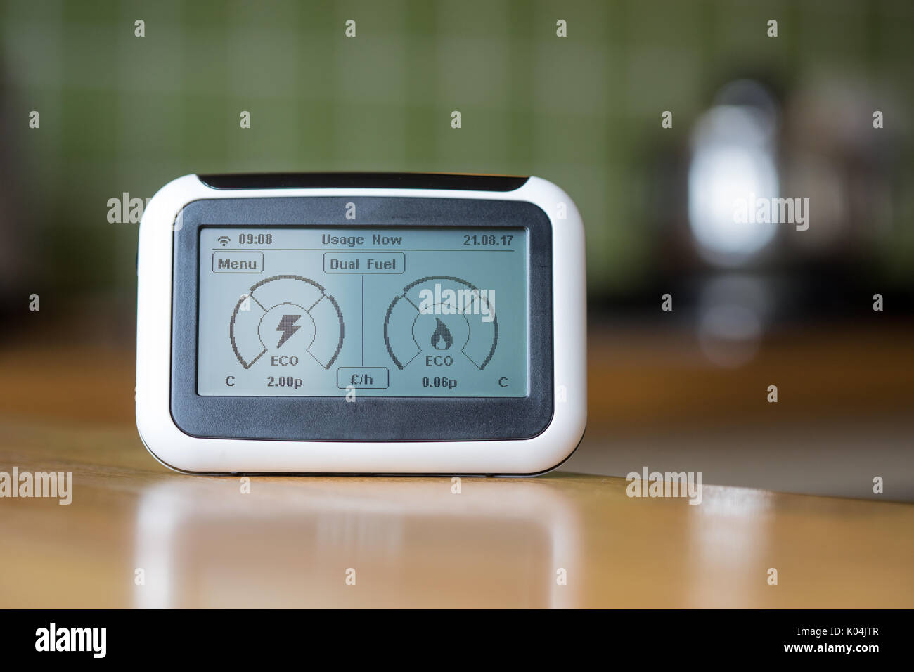 Domestic Energy Smart Meter on a Kitchen Worktop Displaying Electricity and Gas Usage in Real Time - Stock Image