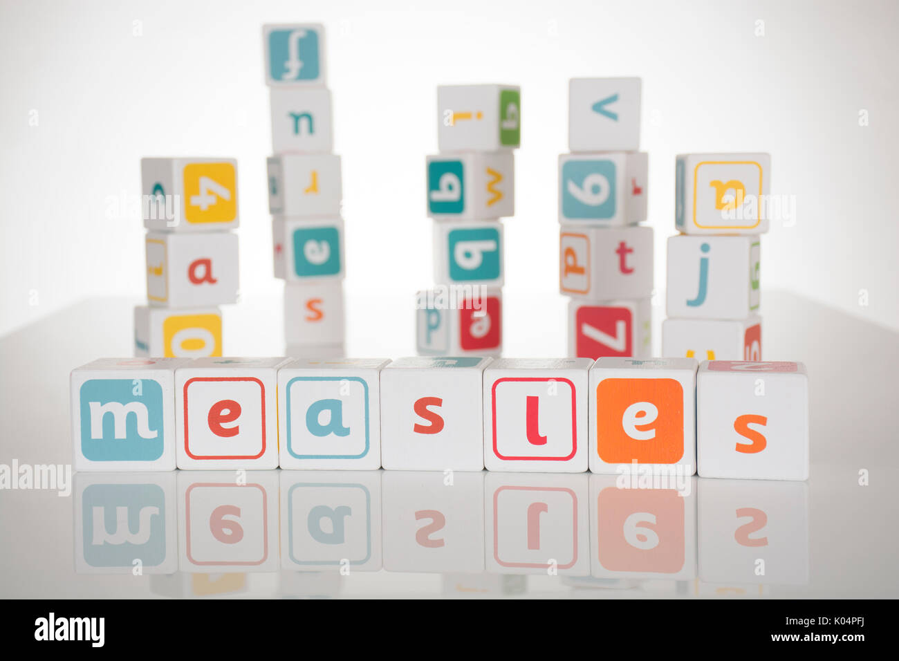 Measles spelled out in toy building blocks - Stock Image