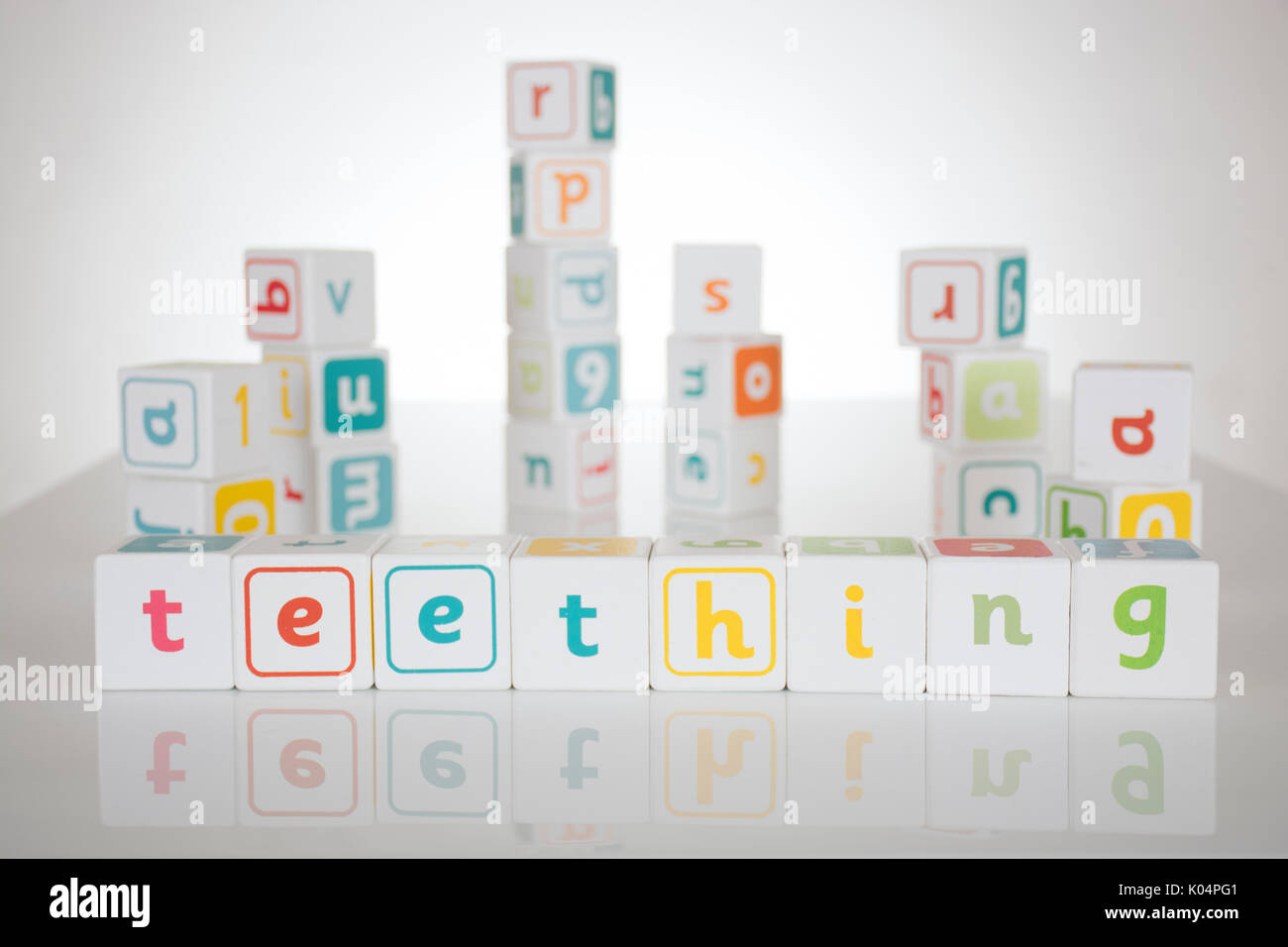 Teething spelled out in toy building blocks - Stock Image