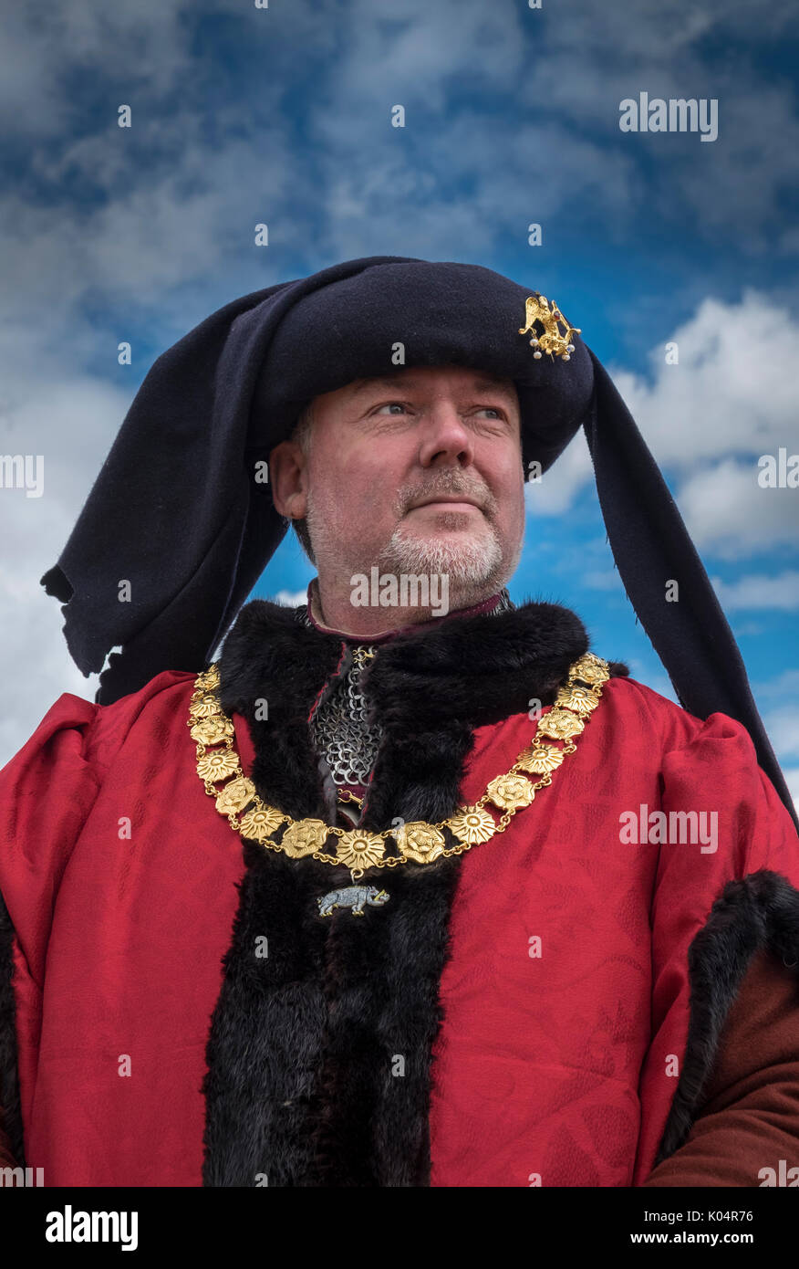 Man dressed in 15th century period costume and regalia at Bosworth Battle re-enactment event, Leicestershire, England UK - Stock Image