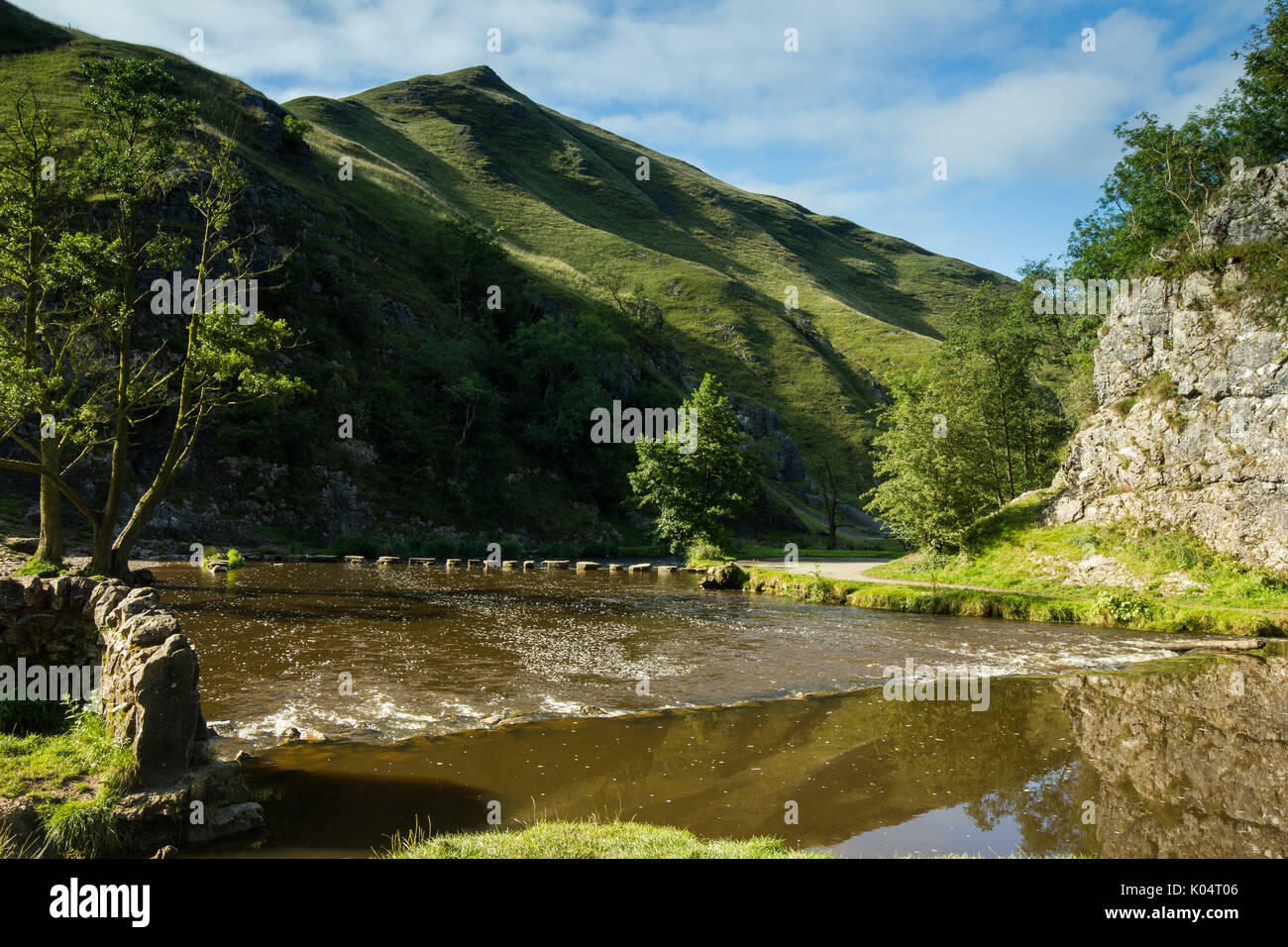 Dovedale Stepping stones with Thorpe Clound in background - Stock Image