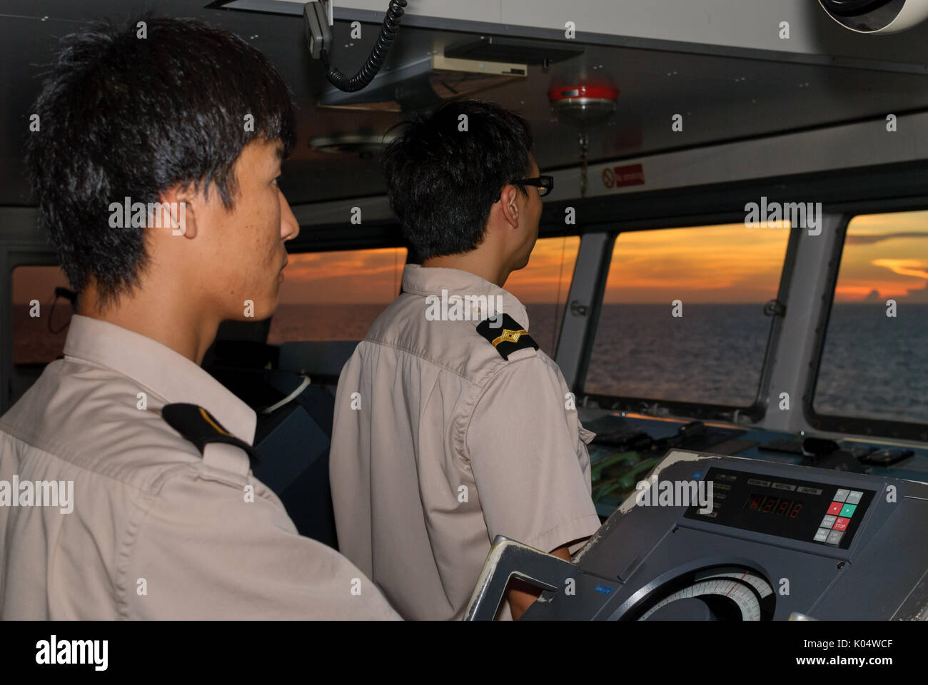 Merchant Marine Navigational Officers on Bridge Watch Stock Photo