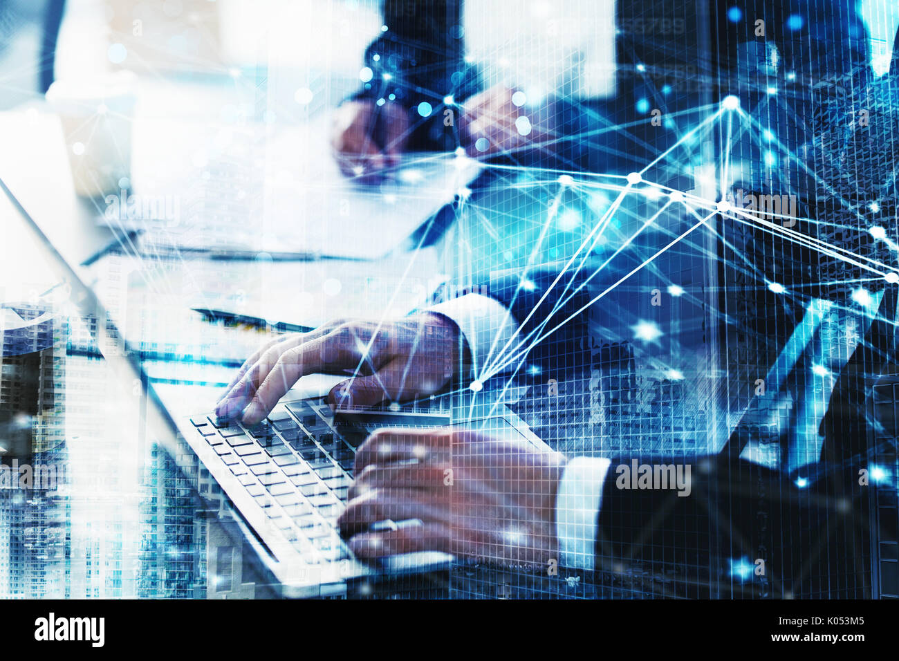 Businessperson in office connected on internet network. concept of partnership and teamwork - Stock Image