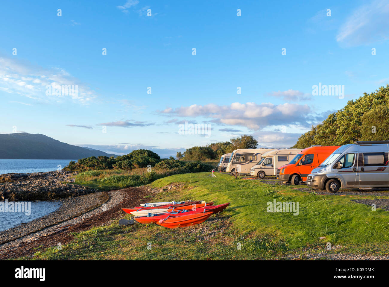 Campervans at a campsite in Craignure at sunset, Isle of Mull, Argyll and Bute, Scotland, UK - Stock Image