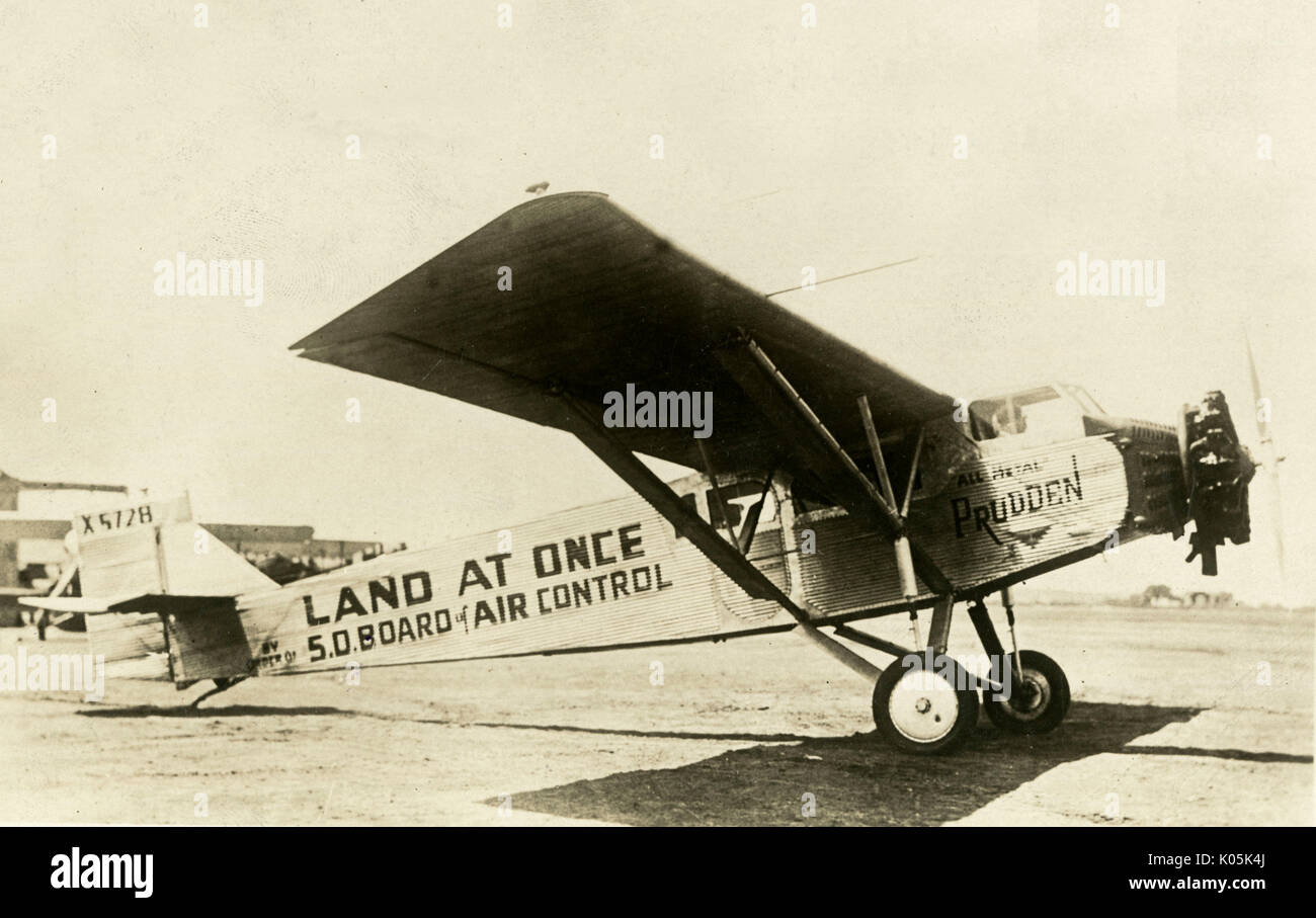 An aeroplane (probably a  Fairchild) of the U.S. air  police carries the words 'LAND  AT ONCE' with which it will Stock Photo