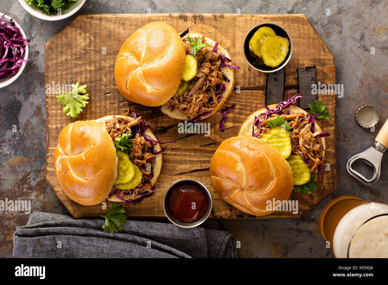 Pulled pork sandwiches with cabbage and pickles - Stock Image