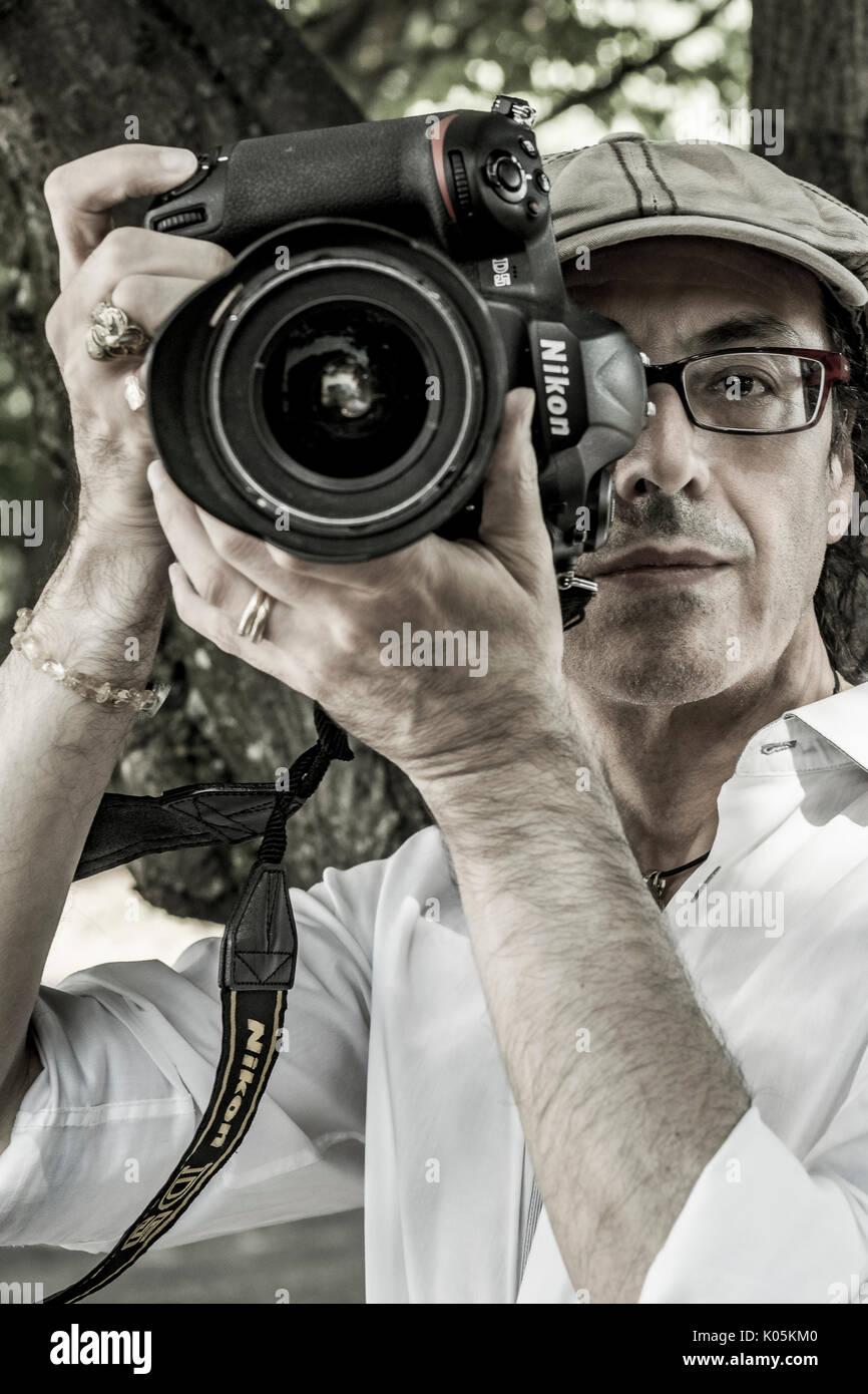 Italian Photographer with Nikon D5 - Stock Image