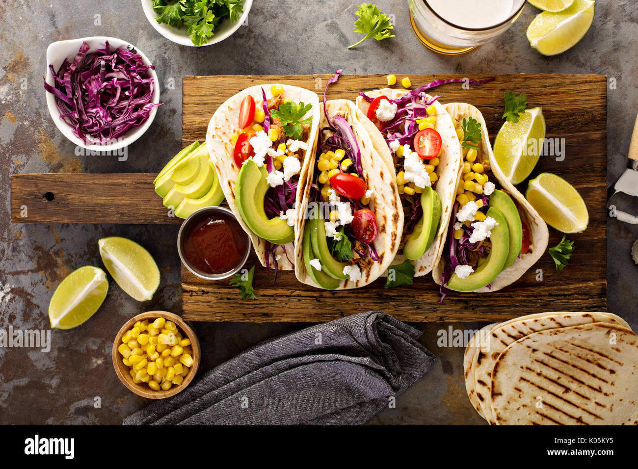 Pulled pork tacos with red cabbage and avocados - Stock Image