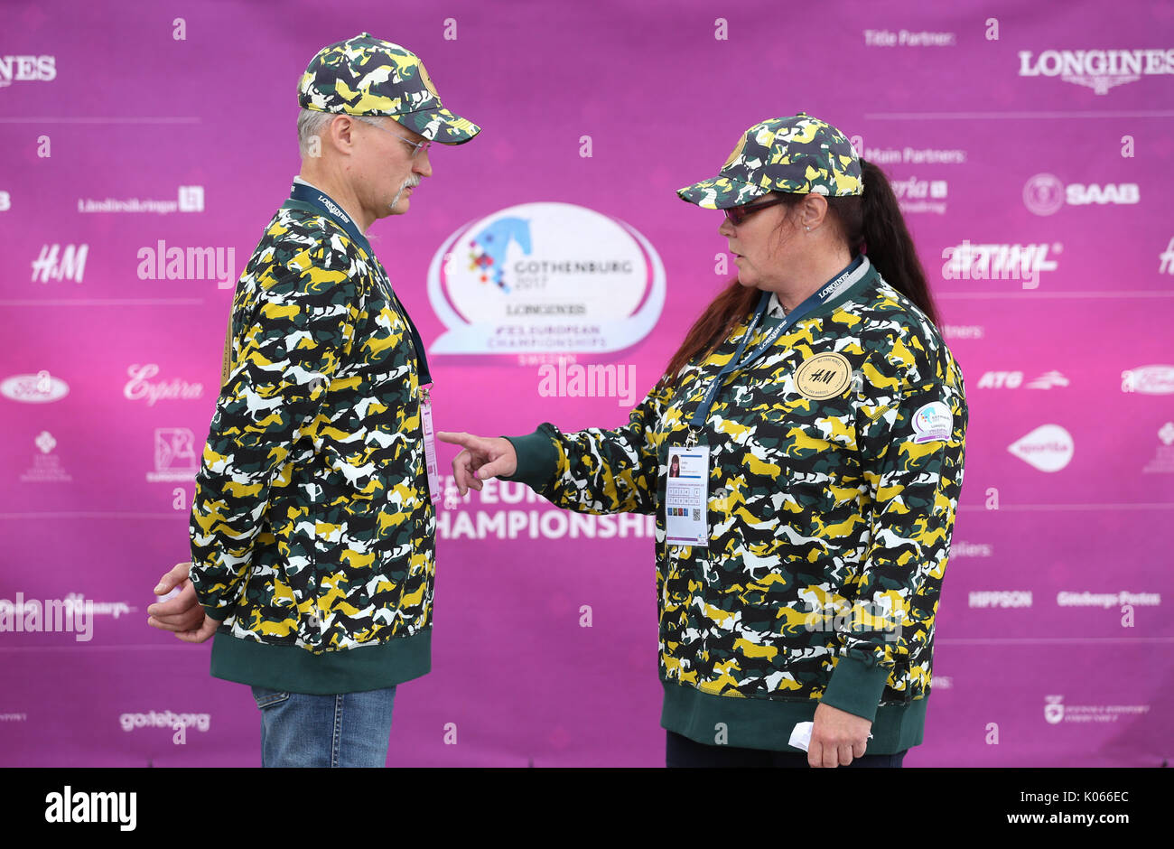 Gothenburg, Sweden. 21st Aug, 2017. Assistants wearing uniforms featuring horse patterns at the Longines FEI European Stock Photo