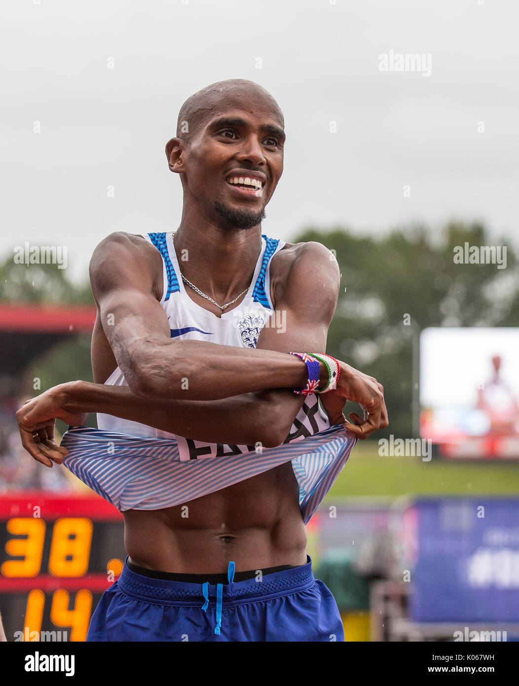 Birmingham, UK. 20th Aug, 2017. Mo FARAH of GBR takes off his shirt to hand to a fellow Brit as his says he is unlikely to race in a Great Britain shirt again during the Muller Grand Prix Birmingham Athletics at Alexandra Stadium, Birmingham, England on 20 August 2017. Photo by Andy Rowland. Credit: Andrew Rowland/Alamy Live News - Stock Image