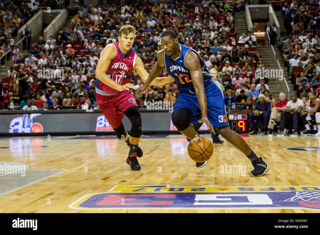 b8523f626a5 Al Thornton  12 3s Company drives ball forward against Lou Amundson  17 Tri-