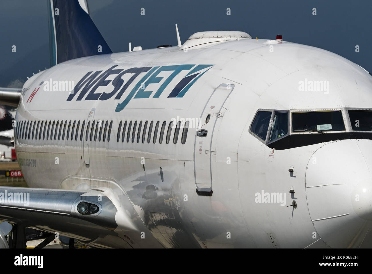 Richmond, British Columbia, Canada. 18th Aug, 2017. A WestJet Airlines Boeing 737-700 (C-GWSP) on the tarmac, South Stock Photo