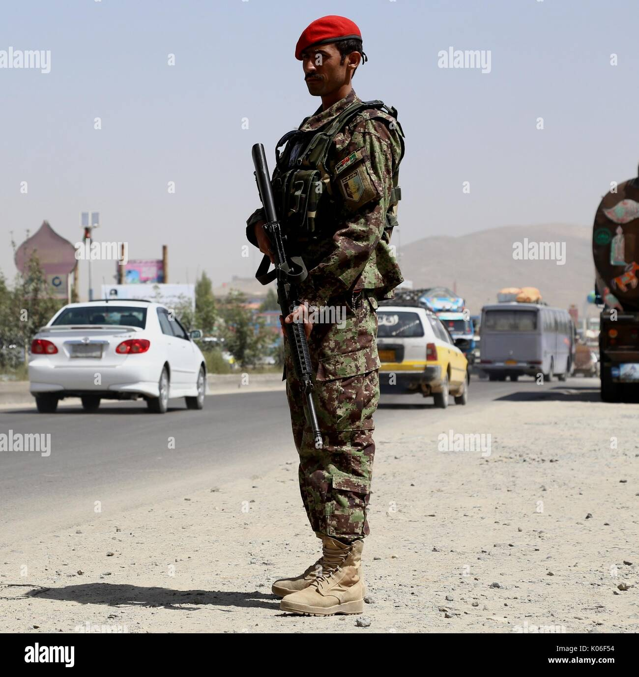 Ghazni, Afghanistan. 22nd Aug, 2017. An Afghan security force member stands guard at a security checkpoint in Ghazni Stock Photo