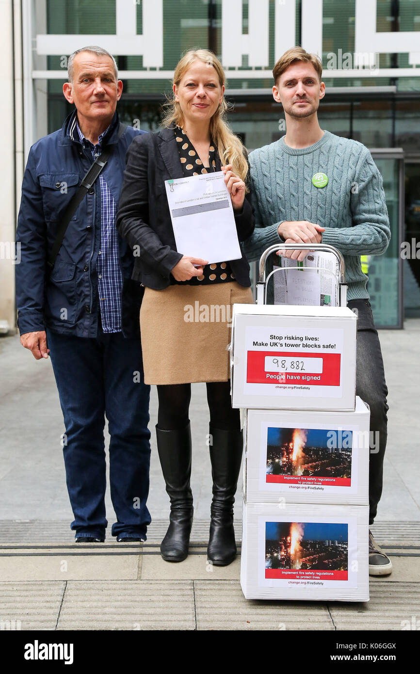 London, UK. 22nd Aug, 2017. Dave Lewis of Lakanal Residents Group, Sian Berry Green party member and John Tyson (l to r). John Tyson hands a 98,882 signature petition to Department for Communities and Local Government in London calling for building crucial fire safety regulations following Grenfell fire on 14 June 2017. Credit: Dinendra Haria/Alamy Live News - Stock Image