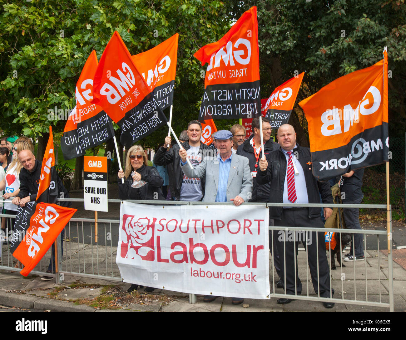 """Southport, Lancashire, UK. 22nd Aug, 2017. GMB protests against NHS cuts outside Southport and Formby NHS Trust hospital as Jeremy Hunt visits on a fact finding tour. The Health Secretary has congratulated staff for """"exceptional improvement"""" made at Southport and Ormskirk. The Trust was the most improved in England between January and March for getting patients home from hospital. GMB, the union for health and care workers, demands the Government marks International Nurses Day to end the 'cruel' public sector pay cap. Credit; MediaWorldImages/AlamyLiveNews. - Stock Image"""