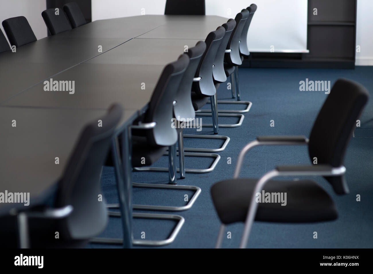 conference table in an empty meeting room - Stock Image