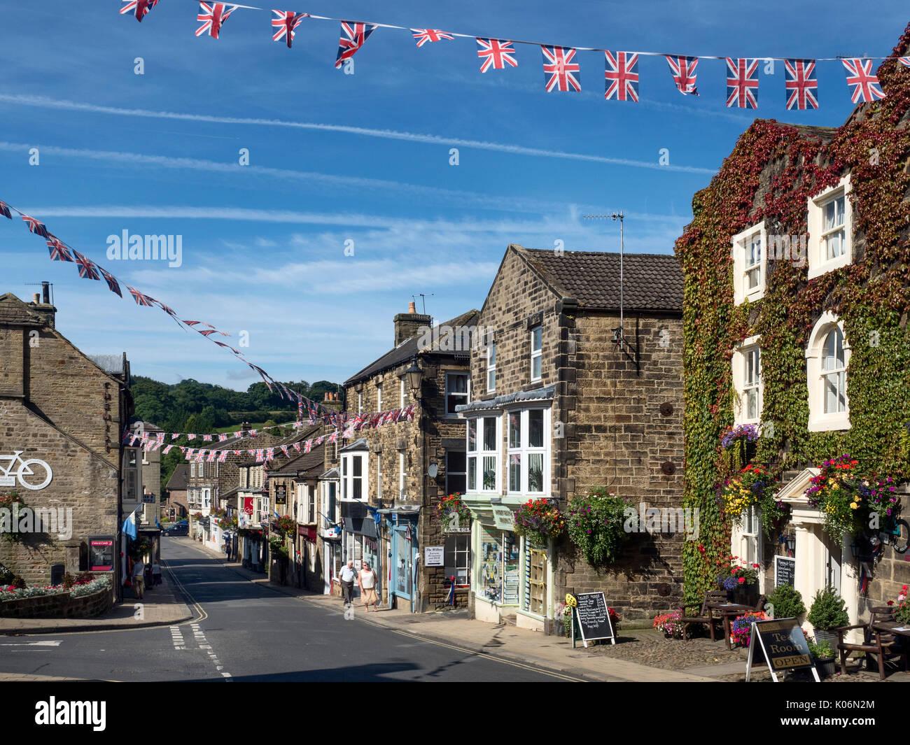 Union Jack Bunting over the High Street at Pateley Bridge Nidderdale AONB Yorkshire England - Stock Image
