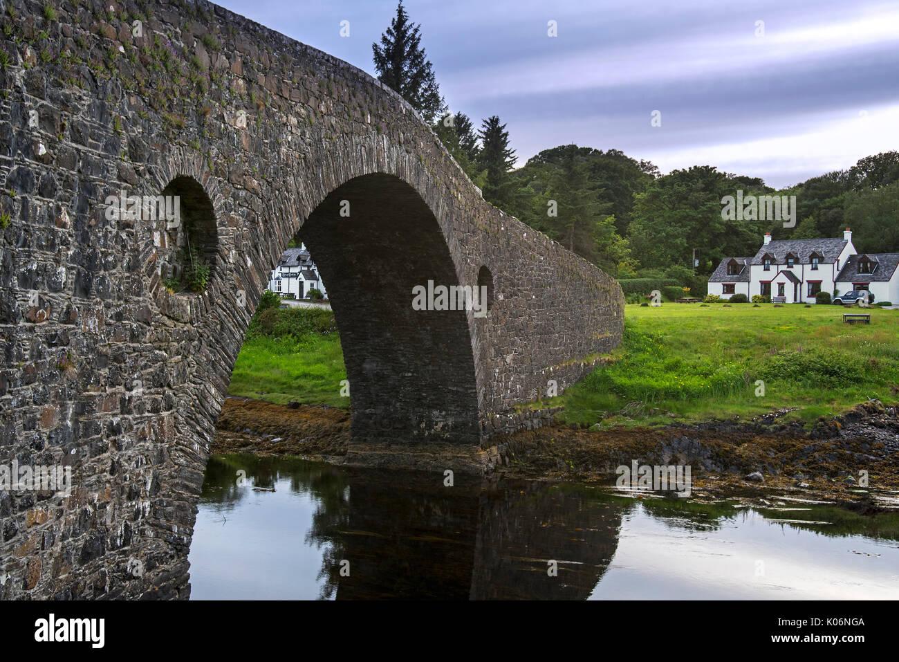 Clachan Bridge / Bridge over the Atlantic, single-arched, hump-backed masonry bridge spanning the Clachan Sound, Argyll, Scotland, UK - Stock Image