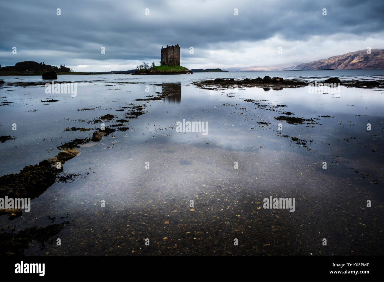 Castle Stalker (Caisteal an Stalcaire) a four-story tower house or keep picturesquely set on a tidal islet on Loch Laich, north of Oban, - Stock Image