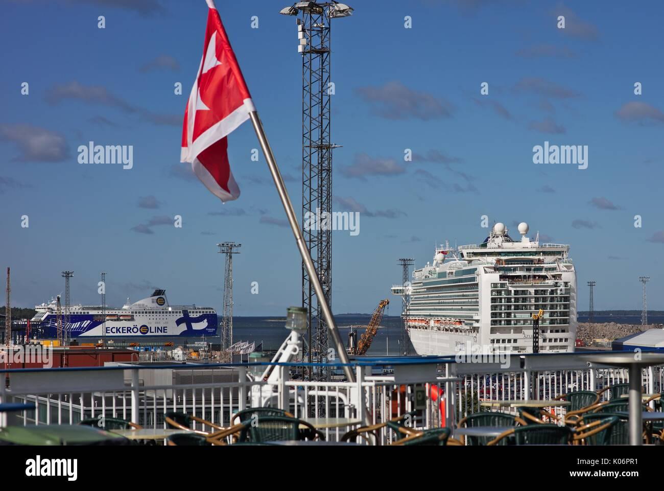 White Maltese cross on red background flag, on cruise ship, Finland - Stock Image