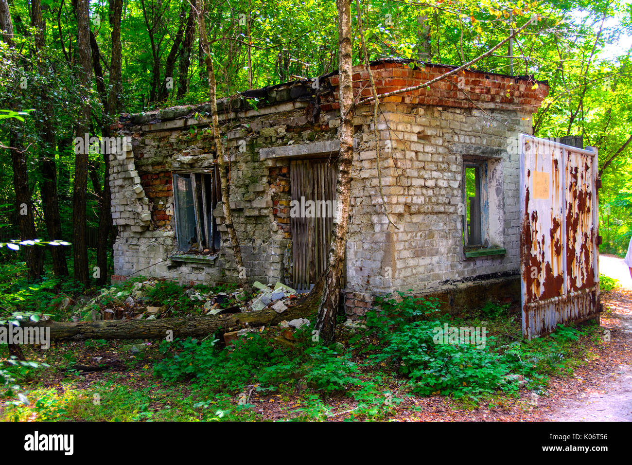 The old abandoned building of the checkpoint. Dead military unit. Consequences of the Chernobyl nuclear disaster, August 2017. - Stock Image