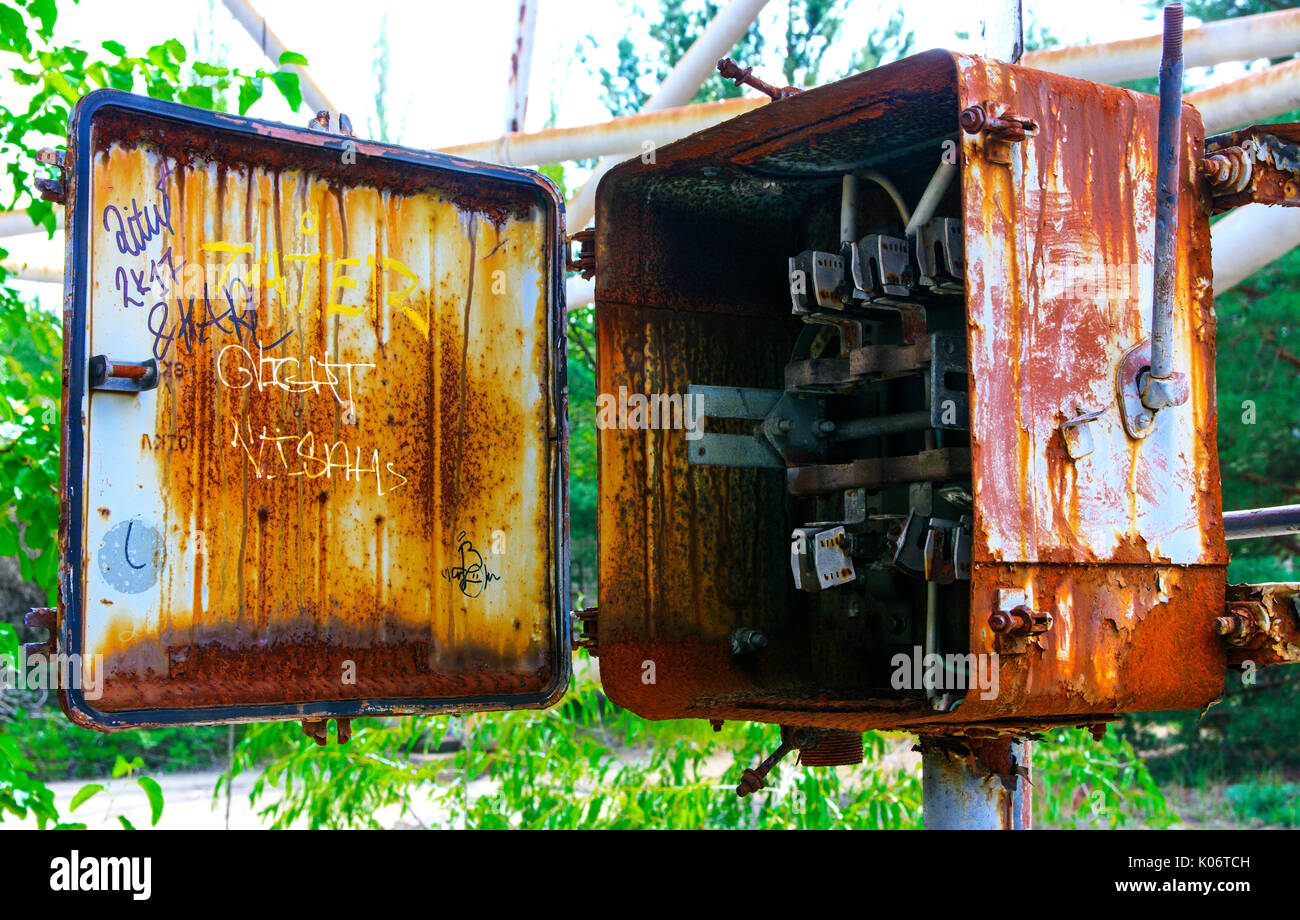 Old rusty junction boxes. Dead military unit. Consequences of the Chernobyl nuclear disaster, August 2017. - Stock Image