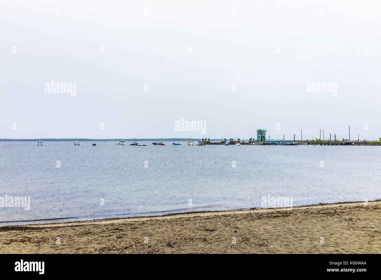 Marina harbor boats in the distance in Lincolnville, Maine small village during rain and beach Stock Photo