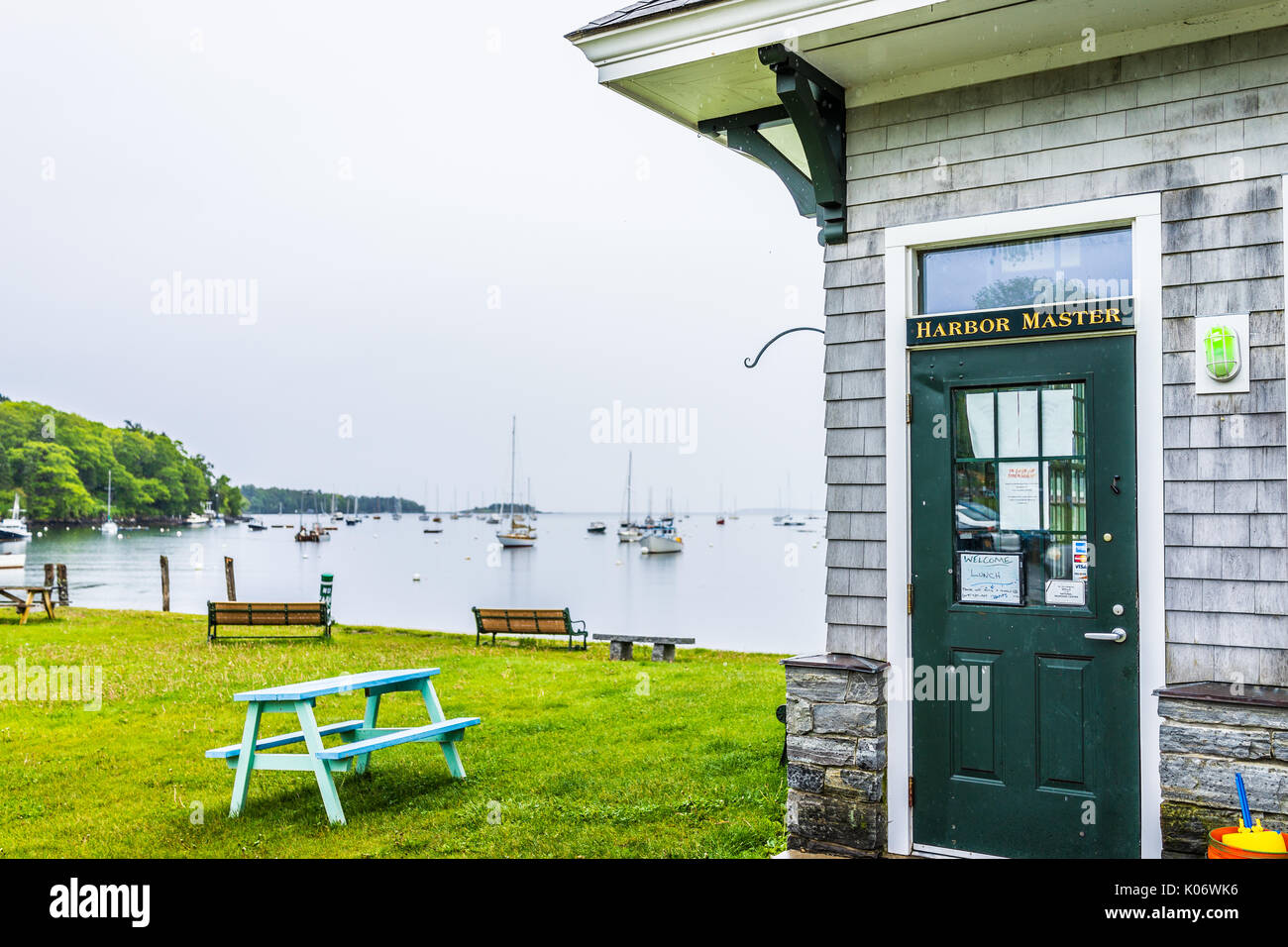Rockport, USA - June 9, 2017: Harbor Master door sign in small Maine village by marina and boats - Stock Image
