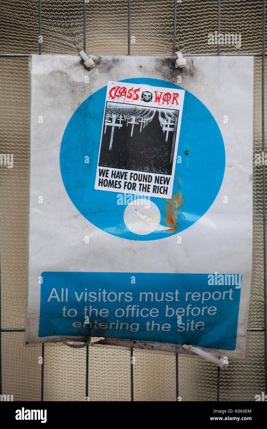 London, UK. 10th August, 2017. A Class War sticker on a sign outside Duke's Lodge in Holland Park, an empty apartment block believed to be owned by Ch - Stock Image
