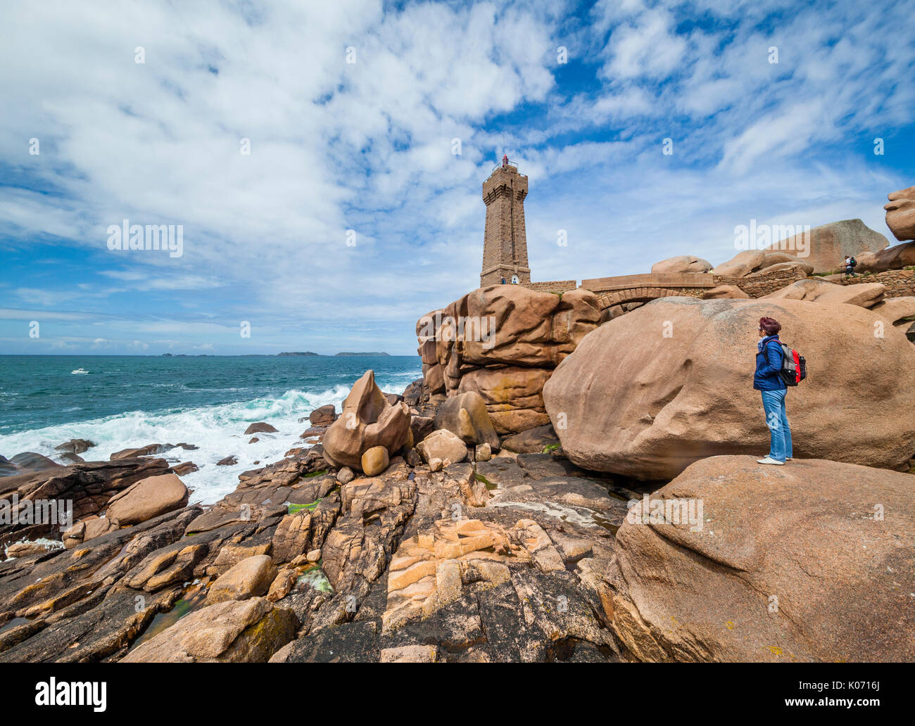 France, Brittany, Cotes d'Armor department, Cote de Granit Rose, Ploumanac'h lighthouse at the Sentier des Douaniers (old customs officers Path) - Stock Image
