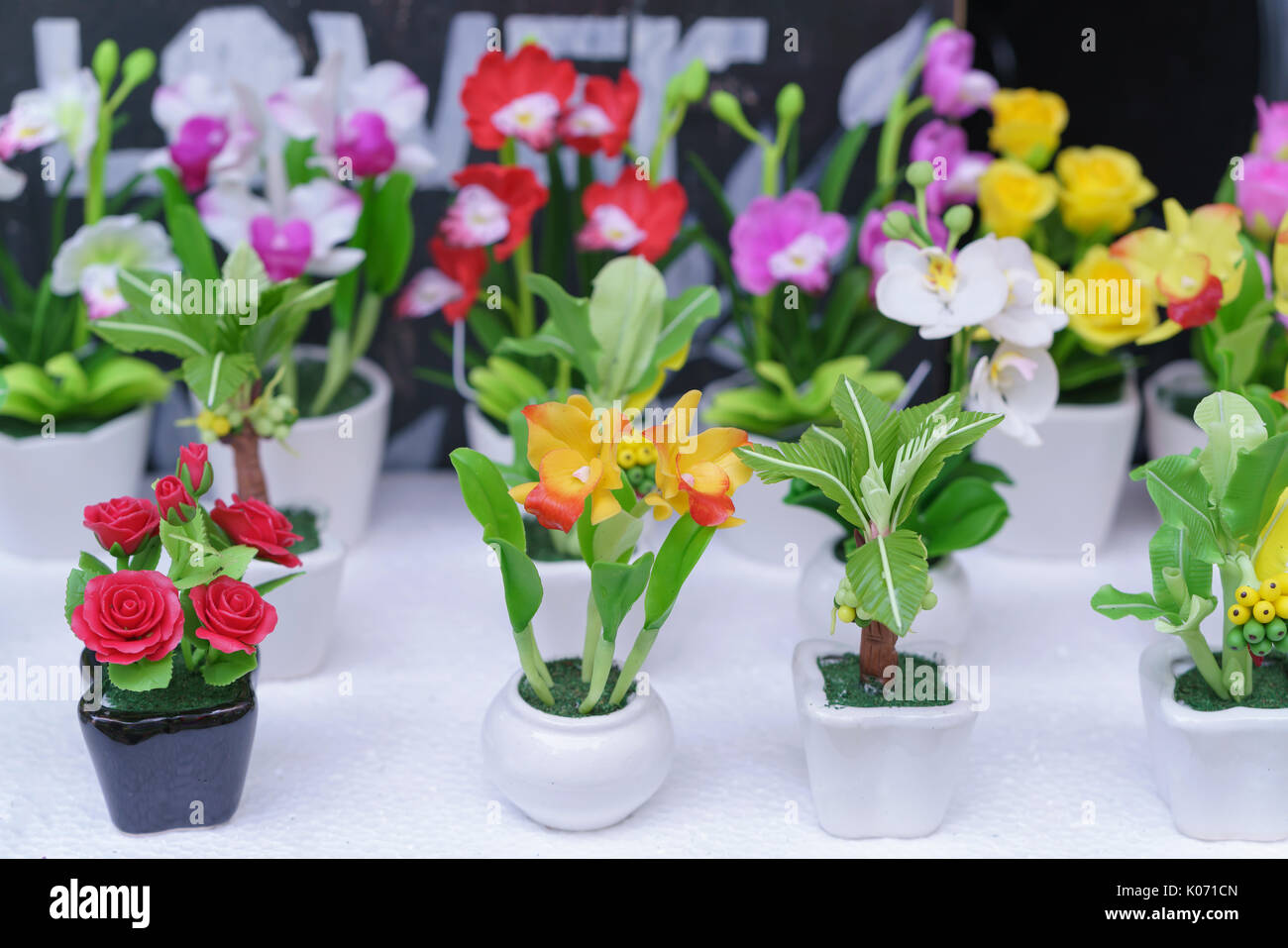 Small clay flower pots with many colors displayed on the shelf. This is a handmade & Clay Pot Making Family Stock Photos \u0026 Clay Pot Making Family Stock ...