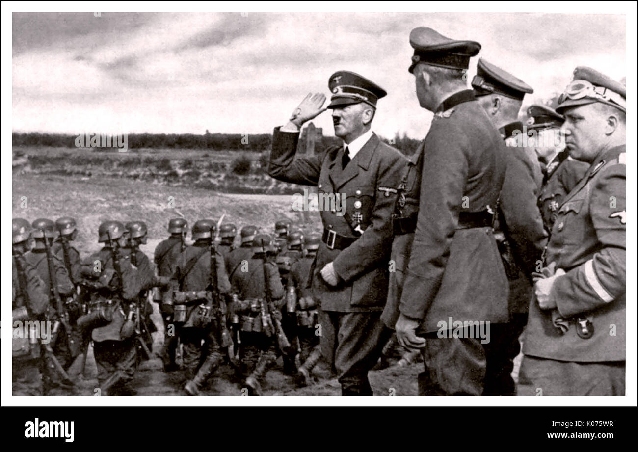 ADOLF HITLER POLAND INVASION Adolf Hitler saluting marching Wermacht troops during occupation of Poland 1939 World War 2 - Stock Image