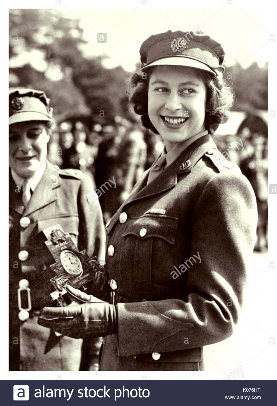 During World War II, the then Princess Elizabeth joined Women's Auxiliary Territorial Service, she received rank promotion to Junior Commander. Aug. 3, 1945 she was presented with a clock to mark her service to the United Kingdom - Stock Image