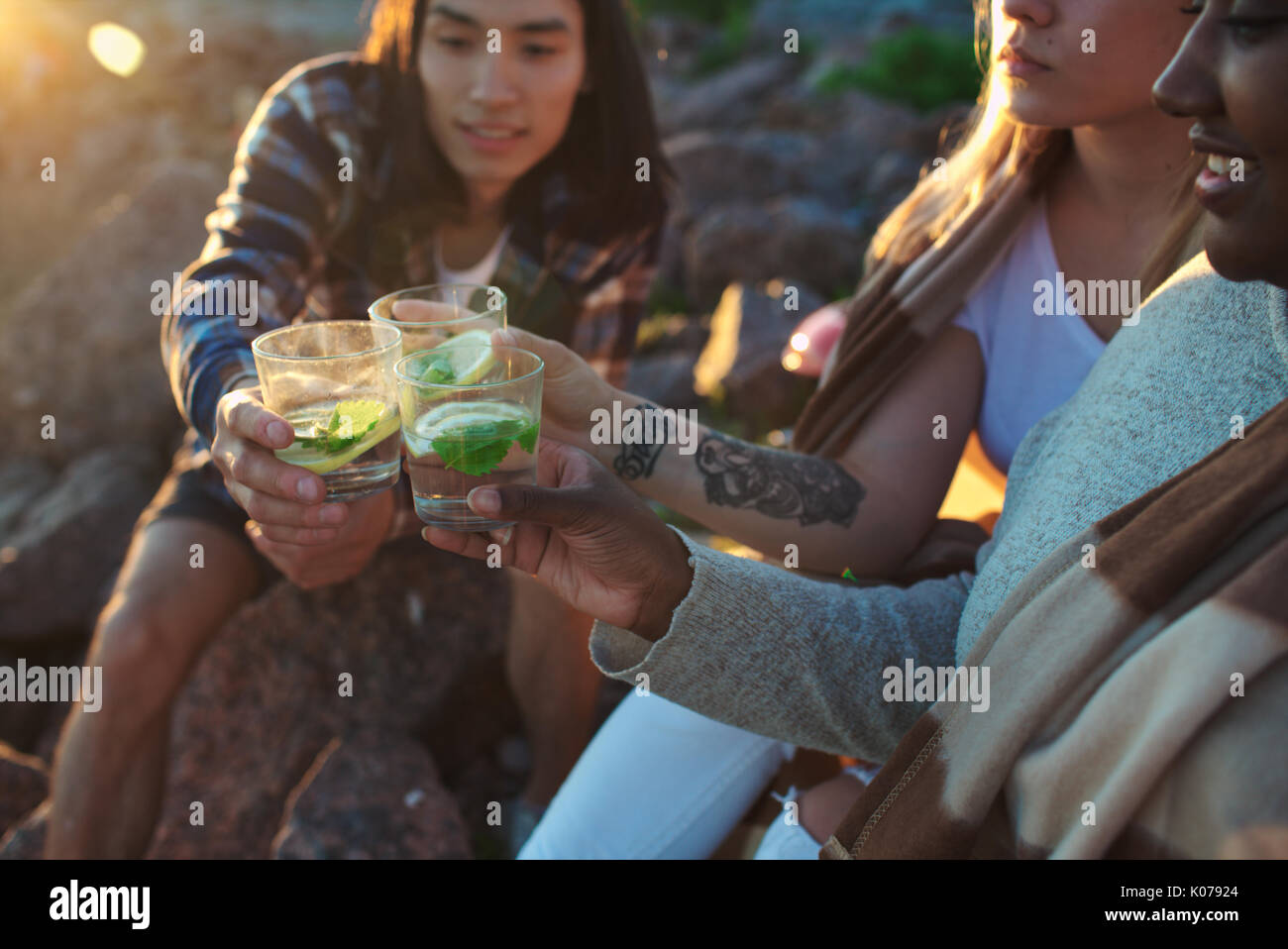 Toasting at beach party - Stock Image