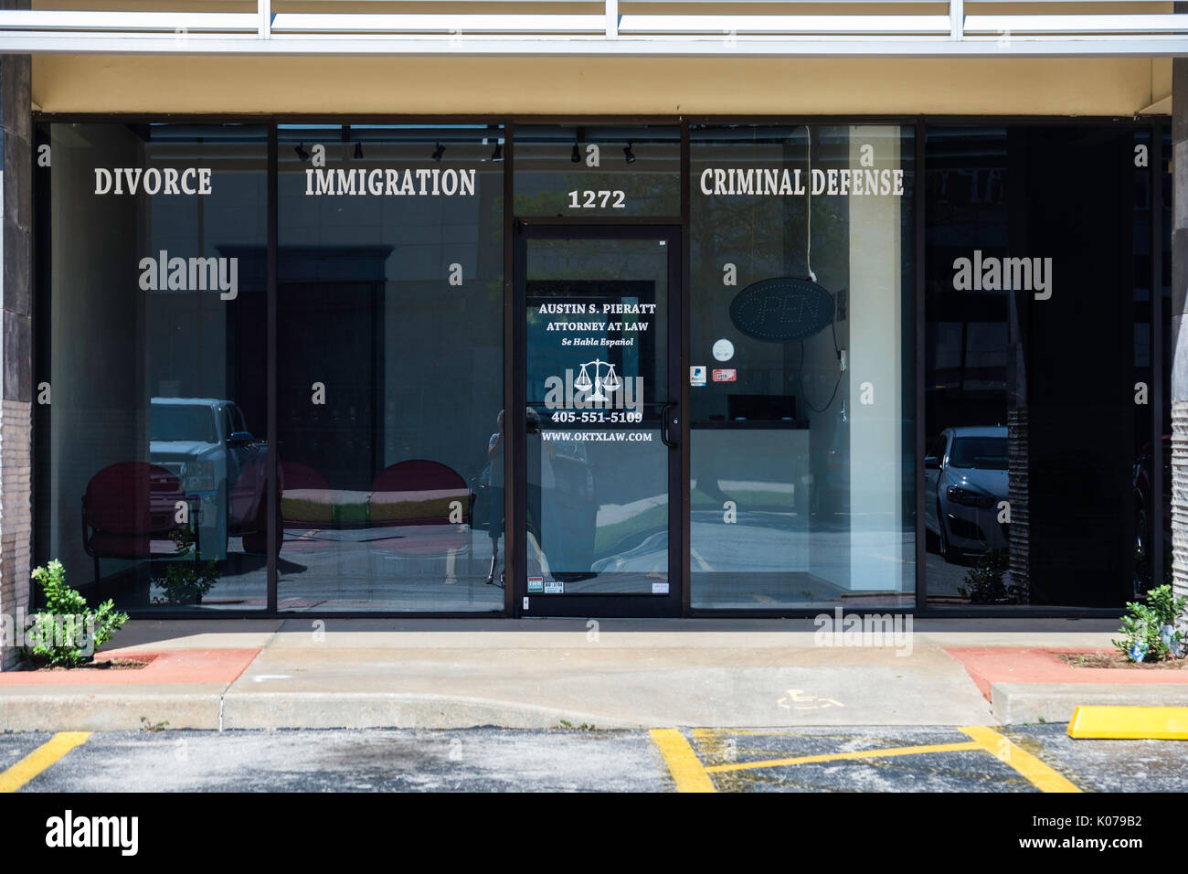 The front exterior of the office of a personal injury attorney also specializing in immigration, divorce, criminal defense in Norman, Oklahoma, USA. - Stock Image