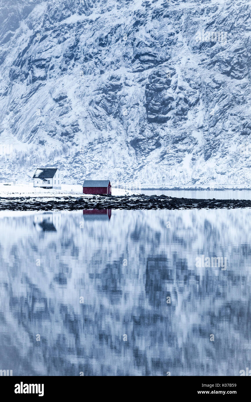 Perfect reflection of mountains and red house, Lofoten Islands, Norway Stock Photo
