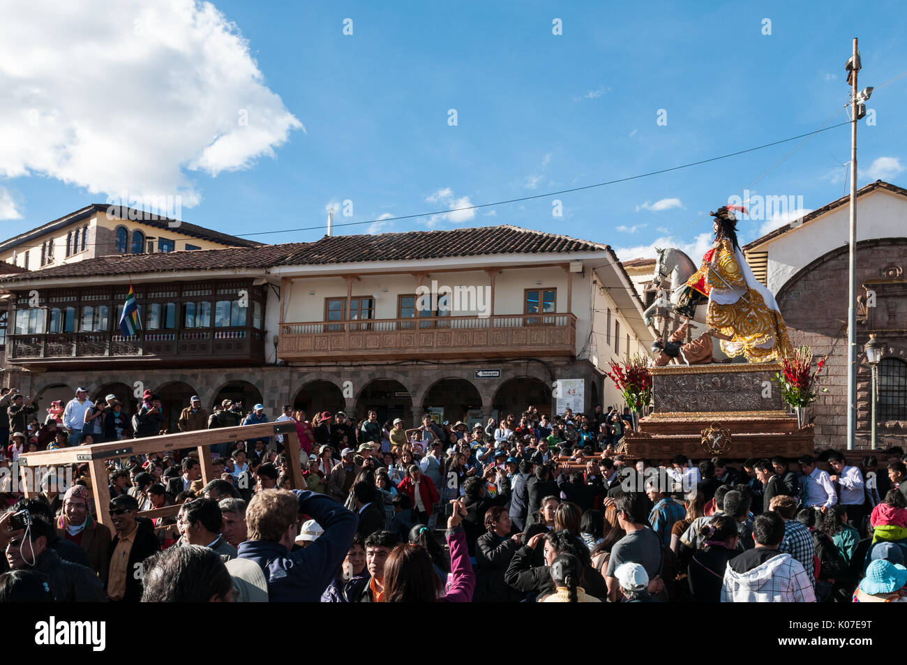 Parishioners carry a large statue of Saint James through crowded Plaza de Armas during celebrations of Corpus Christi, Stock Photo