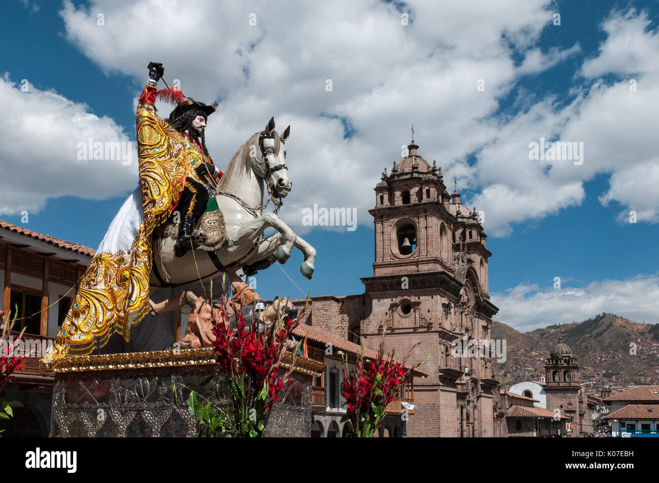 A statue of Saint James with Church of la Compania de Jesus in the background during Corpus Christi celebrations Stock Photo