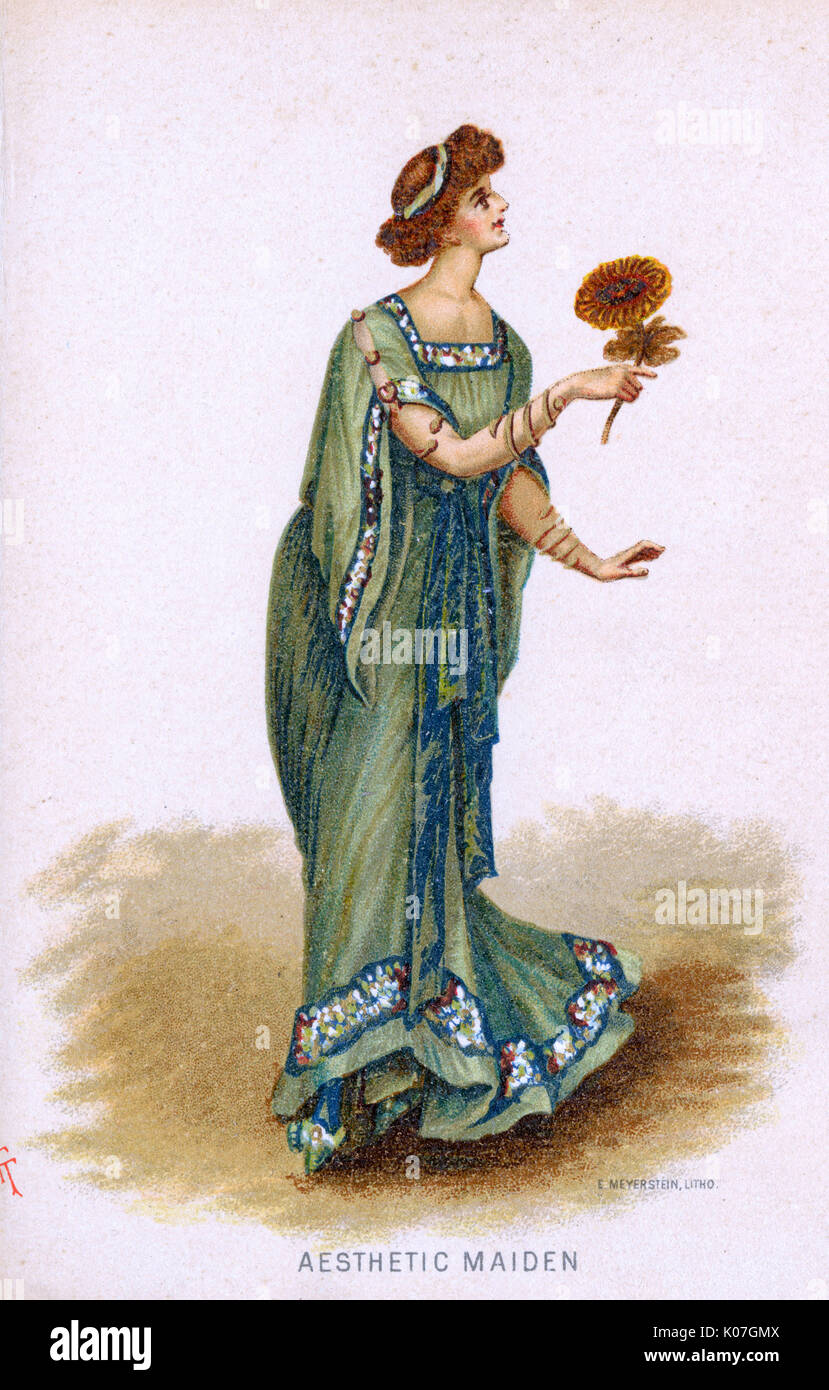 Yellow-green classically  inspired gown with peacock  blue & patterned border. Satirical take on Artistic  dress that made an appearance  in England from the late 1870s      Date: 1884 - Stock Image