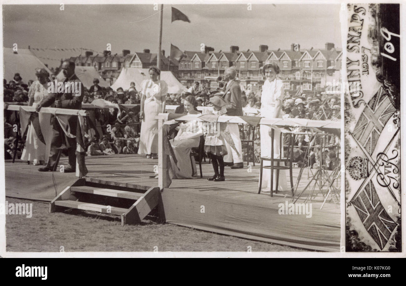 Announcing the winner of a beauty pageant - South Coast (West Sussex) seaside resort.     Date: 1937 - Stock Image